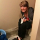 A guy breaks into the bathroom to videotape his girlfriend peeing on the toilet while eating some cotton candy.