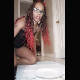 An attractive black girl wearing glasses takes a shit and a piss onto a paper plate and shows her product off to the camera. Vertical format video. Over 2 minutes.