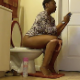 A black woman with short hair records herself farting repeatedly and pissing while sitting on a toilet. She talks about the foods she recently ate to make her fart so much. She may have pooped as well because she wipes her ass. Over 5 minutes.