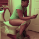 A black woman with short hair records herself pissing, farting and shitting while sitting on a toilet. She shows us her finished product in the toilet bowl. She talks about her latest cleansing diet. Over 10.5 minutes.