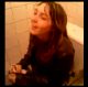 A French girl is having trouble taking a shit while sitting on a toilet as her friend films her difficulty. Low-quality video.