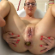 A pretty, blonde, Romanian girl wearing glasses takes a large shit and a piss while lying in a bath tub. Presented in 720P HD. About 1.5 minutes.
