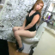 A pretty, redhead girl farts loudly and repeatedly sitting on a toilet while squirming and wiggling around. Recorded in a voyeuristic style. It gets wet-sounding with a little bit of pooping. Presented in 720P HD. About 4 minutes.