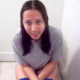 A brunette girl cuts some great, wet-sounding farts as she sits on a toilet. Her friend faithfully records the event on video while laughing in the background.
