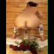 A woman pisses and shits into a flower vase. She adds flowers to the vase so that they can take nourishment from her fresh load. Vertical format video. About 3 minutes.