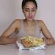 An attractive British girl eats some of her fish & chips meal, then takes a massive shit on top of it. Presented in 720P HD. 105MB, MP4 file. About 7 minutes.