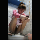A pretty Asian woman takes a piss and shit into a floor toilet while playing with her mobile phone. She uses a spray hose to clean off her ass and pussy. Video appears to have been captured by hidden camera. 720P vertical HD format. About 3 minutes.
