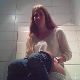 A hidden camera records an attractive woman pissing and shitting while sitting on a toilet. Plops are solid at first, then a load of soft, goopy shit comes out all at once and heard quite well, despite limited audio range. 720P HD. About 3 minutes.