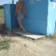 We follow a blonde woman into a beach outhouse as she takes a piss and a shit. She quickly leaves, and we get a glimpse of the nasty pit beneath. About 2 minutes.