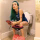 A very pretty girl with wild, green hair records herself sitting on a toilet. She takes a piss, and then after some grunting and pushing, she wipes her ass. Unfortunately, no plops can be heard. About 4.5 minutes.