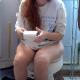 A girl with red hair is recorded pissing and taking a shit while sitting on a toilet. Poop sounds are audible. We are not sure if this is a real voyeur video. About a minute.
