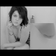 An attractive girl is captured on video from two different perspectives in a dual-camera, picture-in-picture video format as she shits into a bathtub :)