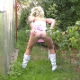 A blonde woman with spiky hair takes a piss and a shit outside in her garden. Presented in 720P HD quality.