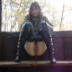 A brunette, European woman takes a shit in a park gazebo. She poop while facing the camera, and then turns around backwards and poops some more. About 3 minutes.