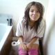 This poop video from Great Britain features a guy video-recording his pretty girlfriend as she shits while sitting on a toilet. Pooping sounds cannot be heard, but she must have gone because he comments about the smell.
