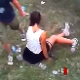 An attractive brunette girl shits while sitting on the lawn at a concert while others watch in disbelief. The crazy things women do!