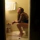 A cute girl is unexpectedly observed through a bathroom doorway as she shits on a toilet. You can hear the plops if you listen carefully. Once she realizes that she has been taped, it is too late. She nearly falls off the toilet trying to close the door!