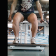 A girl records herself between the legs and behind her ass as she takes a shit and a piss into a public toilet at her gym after working out in 3 different scenes. 720P vertical format HD video. About 4 minutes.
