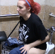 A girl with red-dyed hair is constipated and has trouble shitting while sitting on a toilet at the local laundromat public restroom. Some pissing is heard, but no pooping. Presented in 720P HD. Over 3 minutes.