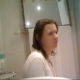 A girl is recorded pissing and shitting with a hidden camera in a bathroom. Pissing and shitting sounds are audible. Wiping can be seen, but no detailed poop action.