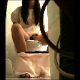 An iPhone is secretly setup in a bathroom and records an unsuspecting woman taking a piss while sitting on a toilet.