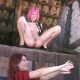 A punk-looking girl with pink hair pees and shits from a high perch while her female friend waits below to catch the products that rain down upon her.