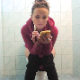 Dressed for a chilly day, a pretty Bulgarian girl sits on a toilet while vaping, pissing and taking a shit. After gently pushing, plops are heard at 2:14 into the clip. Some farts is heard later as well. Presented in 720P HD. About 8.5 minutes.