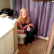 Some guy barges in on his blonde girlfriend as she takes a shit sitting on a toilet. No poop action is seen, but some very subtle pooping sounds can be heard at the exact start of video. Presented in 1080P vertical HD format. Over a minute.