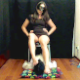 A dark-haired Spanish girl speaks in a demeaning way to a masked man lying silently on the floor. She sticks her ass in his face, then sits down on a potty chair and shits onto his face. 2 perspectives shown. 720P HD. 103MB, MP4 file. About 7 minutes.