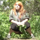 A red head woman is recorded taking a shit while squatting under cover of vegetation in an outdoor location. The view shows poop action quite clearly. Nice video! Over a minute.