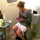 A girl that appears to be drunk is video-recorded taking a shit while sitting on a toilet. A plop is barely audible, but she wipes and shows us the dirty toilet paper.