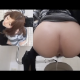 A Japanese girl takes a runny dump into a floor toilet with voyeuristic filming style and dual-angle, picture in picture videography. High-quality video.