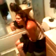 Some guy video-records his girlfriend sitting on a toilet taking a shit. She complains that the shit is full of peppers and is burning her asshole as it slowly slides out of her backside. No audible pooping sounds.