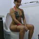 A pretty Latina girl invites us into her bathroom where she takes a piss and appears to shit while sitting on a toilet. No pooping sounds are heard. She pisses again while standing. Several time edits. 720P HD. 123MB, MP4 file. Over 6.5 minutes.