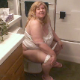 A fat, blonde woman sits on a toilet and speaks to you as if she is your mother. That makes it okay for you to watch her going pee pee and blowing stinkers on the potty. No audible pooping, but she does wipe her ass. About 5 minutes.