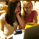 Two girls are surfing the Web, when one of them (the blonde on the right) blows a ripping fart and scares off her friend!
