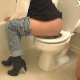 Joy shits and pees while sitting on a toilet in two scenes. In both scenes, she lifts her ass off of the toilet seat so we can see the shit sliding out of her ass.