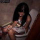An exceptionally pretty girl is seen sitting on a toilet reading. She appears to be taking a shit. Although we cannot hear any plopping sounds, the view is absolutely amazing!