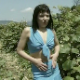 A European, brunette woman massages her ass and then takes a shit while standing among some grape vines. About 5.5 minutes.