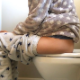 A girl takes a morning shit while sitting on a toilet. Audible pooping and plops are heard. She is out of toilet paper, so must use a box of tissues instead. Presented in 720P HD. Over 3.5 minutes.