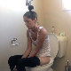 A skinny girl takes a morning shit while sitting on a toilet. Audible pooping and some heavy plops are heard. Some pissing, too. She is out of toilet paper, so must use a box of tissues instead. Presented in 720P HD. About 6 minutes.