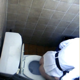 A daring cameraman peers over a public restroom stall wall and video records a Korean woman taking a shit into a toilet. Plop sounds and some poop action is visible from above. Over a minute.