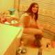 A very brief video clip of a brunette girl pooping on a toilet.