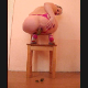 Laila takes a large, soft dump while squatting over the edge of a wooden chair.