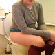 A girl takes a piss and a shit while sitting on a toilet, then wipes herself. She does not show her entire face, nor does she show the poop. Audible pissing and plop sounds. Over 2 minutes.