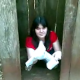 A Spanish-speaking video featuring a girl who just finished shitting in an outhouse and is wiping her ass.
