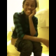 A black girl is video recorded as she has trouble taking a shit in a public restroom. She is camera shy, and so is her turd. No audible pooping sounds.