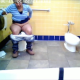 A hidden camera records a pudgy Hispanic woman as she takes a shit in a public restroom and talks on her cell phone. See Movie # 5497 for more. Over 4.5 minutes.