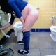 A hidden camera records a pregnant, Hispanic woman as she takes a piss while bending over a public toilet. Next, she covers the seat with toilet paper, sits down on the toilet, and takes a shit. Poop sounds are difficult to hear. About 5 minutes.