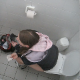 A daring, but lucky cameraman manages to record a girl shitting in a public restroom toilet stall. Some poop action and movement can be seen behind her ass. Product is slightly visible when she sits forward to wipe her ass. Over 2.5 minutes.